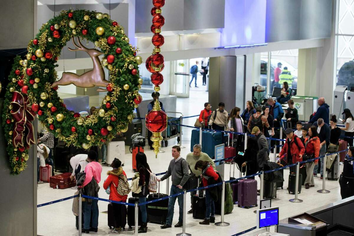 Holiday travel can be fussy, especially when security checkpoints can be a headache. Airline passegers make their way through the ticketing area of Terminal C at George Bush Intercontinental Airport in advance of the Christmas holiday on Friday, Dec. 21, 2018, in Houston.