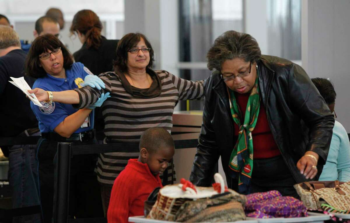 Barbara Devaraj of Houston is hand searched as she goes through security at Hobby Airport, Wednesday, Dec. 15, 2010, in Houston. TSA security checkpoint waits are expected to get longer this holiday season, with over 2.8 million travelers expected to fly on the Sunday after Thanksgiving.
