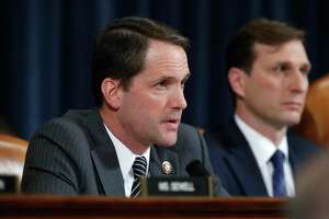 Rep. Jim Himes, D-Conn., speaks to Jennifer Williams, an aide to Vice President Mike Pence, and National Security Council aide Lt. Col. Alexander Vindman, as they testify before the House Intelligence Committee on Capitol Hill in Washington, Tuesday, Nov. 19, 2019, during a public impeachment hearing of President Donald Trump's efforts to tie U.S. aid for Ukraine to investigations of his political opponents. (AP Photo/Alex Brandon)