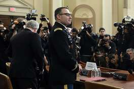 National Security Council aide Lt. Col. Alexander Vindman, and his attorney Michael Volkov, arrive to testify before the House Intelligence Committee on Capitol Hill in Washington, Tuesday, Nov. 19, 2019, during a public impeachment hearing of President Donald Trump's efforts to tie U.S. aid for Ukraine to investigations of his political opponents. (AP Photo/Susan Walsh)