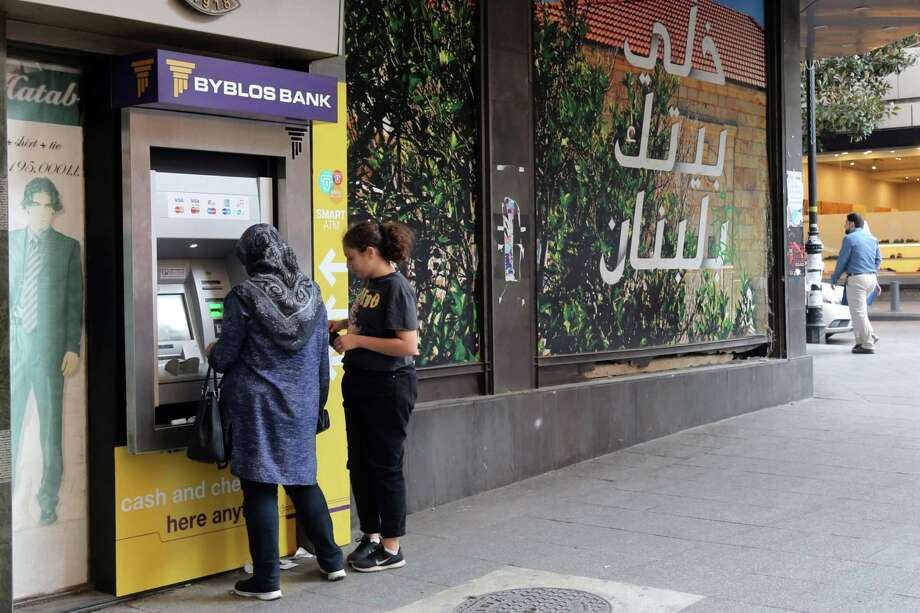 A woman withdraws money from a Byblos Bank ATM in Beirut. Photo: Bloomberg Photo By Hasan Shaaban / © 2019 Bloomberg Finance LP
