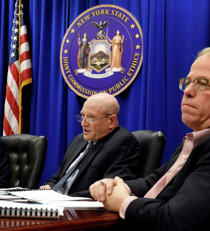 Joint Commission on Public Ethics commissioners, George H. Weissman, left, and William P. Fisher, right, weigh on whether to release an inspector general's leak probe letter on Tuesday, Nov. 19, 2019, during a meeting in Albany, N.Y. The letter was received last month from the state inspector general's office explaining why it had failed to substantiate an alleged leak from the ethics watchdog's secret deliberations. (Will Waldron/Times Union)