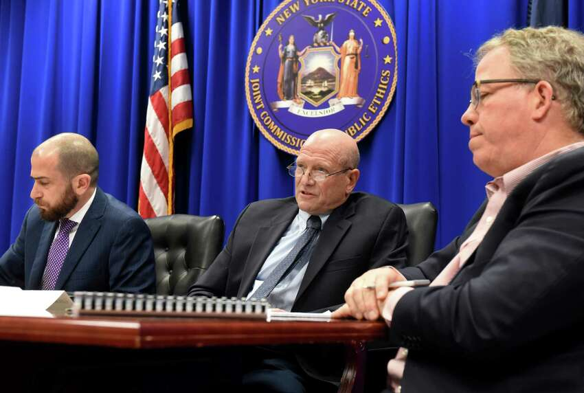 Joint Commission on Public Ethics commissioners, George H. Weissman, center, and William P. Fisher, right, and JCOPE deputy general counsel, Martin Levine, left, weigh on whether to release an inspector general's leak probe letter on Tuesday, Nov. 19, 2019, during a meeting in Albany, N.Y. The letter was received last month from the state inspector general's office explaining why it had failed to substantiate an alleged leak from the ethics watchdog's secret deliberations. (Will Waldron/Times Union)