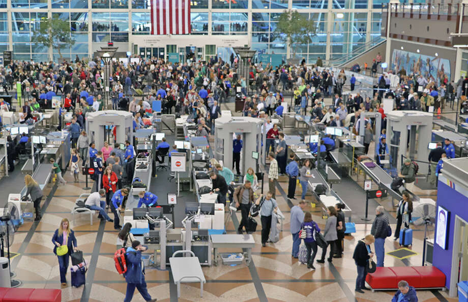 TSA expects airport screening lines to increase by 600,000-700,000 travelers a day around Thanksgiving. Photo: Jim Glab