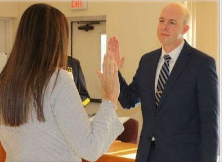 Wilton Police Dispatcher William Whitman was sworn in as the Wilton Police Department's newest patrol officer on Wednesday, Nov. 13. He began his training at the Connecticut Police Academy on Friday, Nov. 15. Photo: Contributed Photo / Wilton Bulletin Contributed