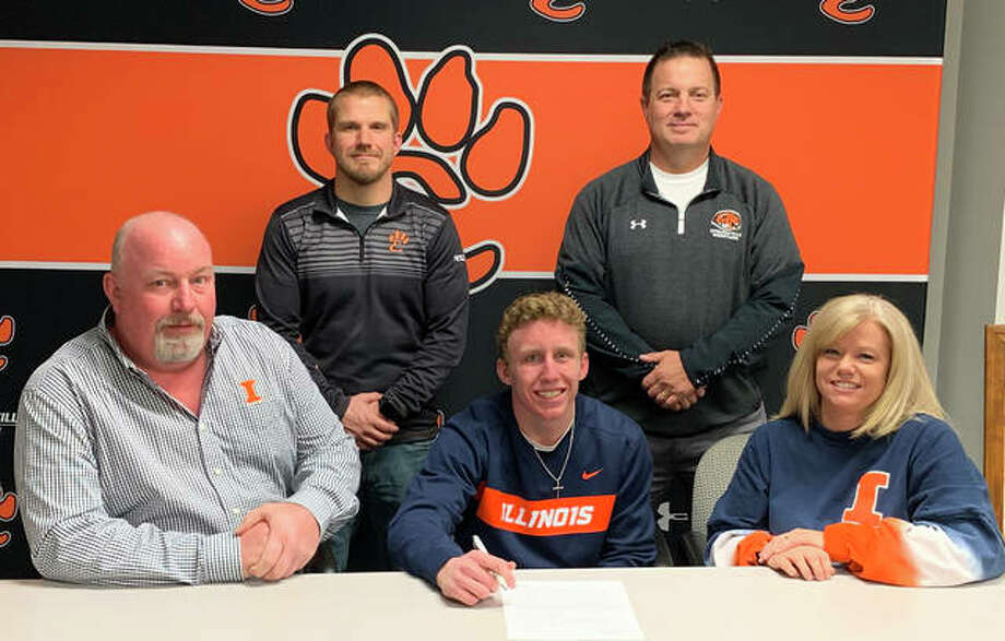 Edwardsville High School senior Luke Odom, seated center, will wrestle for the University of Illinois. He is joined by his family, EHS coach Jon Wagner and EHS assistant coach Eric Pretto. Photo: Matt Kamp|The Intelligencer