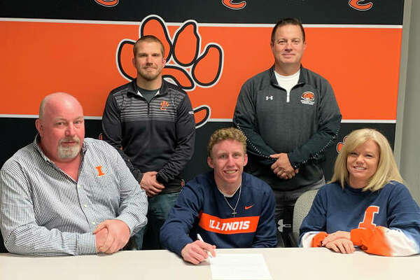 Edwardsville High School senior Luke Odom, seated center, will wrestle for the University of Illinois. He is joined by his family, EHS coach Jon Wagner and EHS assistant coach Eric Pretto.