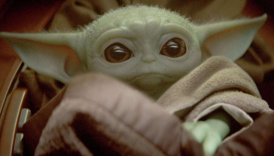 "Baby Yoda is known simply as ""the Child"" in ""The Mandalorian,"" the first live-action ""Star Wars"" series. Photo: Disney Plus / Disney Plus"