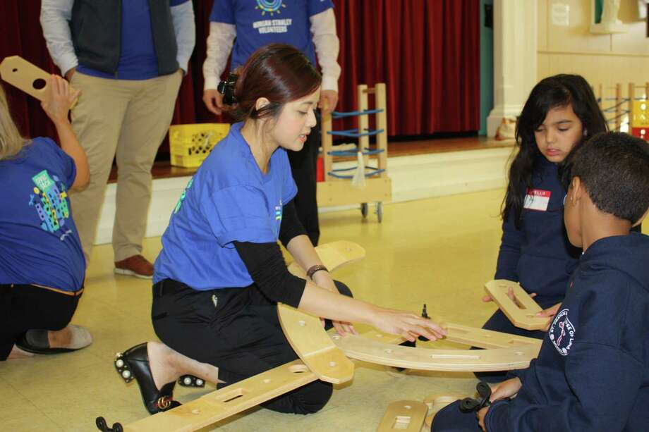 Morgan Stanley volunteer Shamira Shahriar works with students from New Haven's St. Francis & St. Rose of Lima School assembling the school's new Rigamajig. Photo: Contributed Photo
