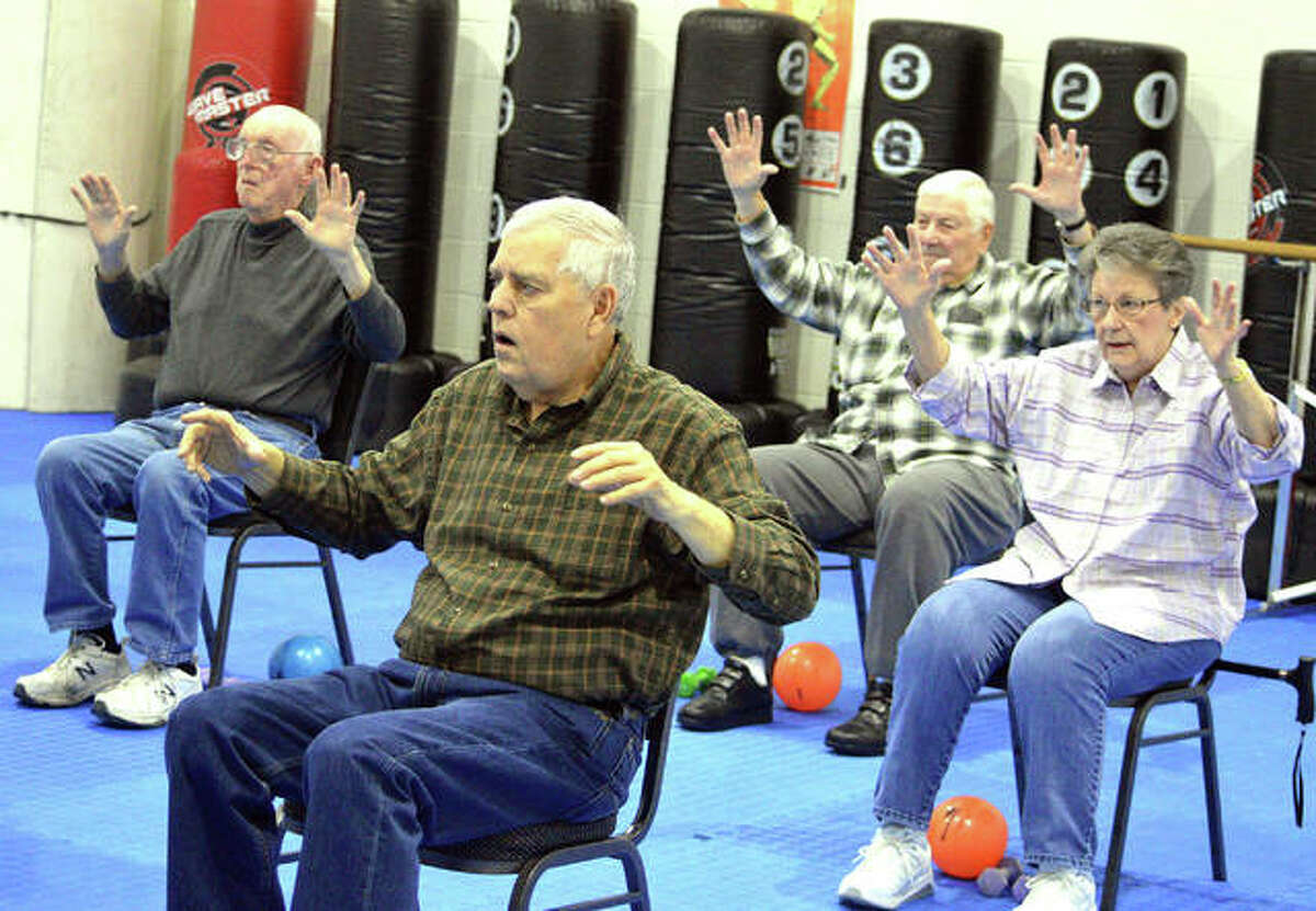 Members of an exercise class for people with Parkinson's disease work out during a recent session at the Niebur Center YMCA in Edwardsville.
