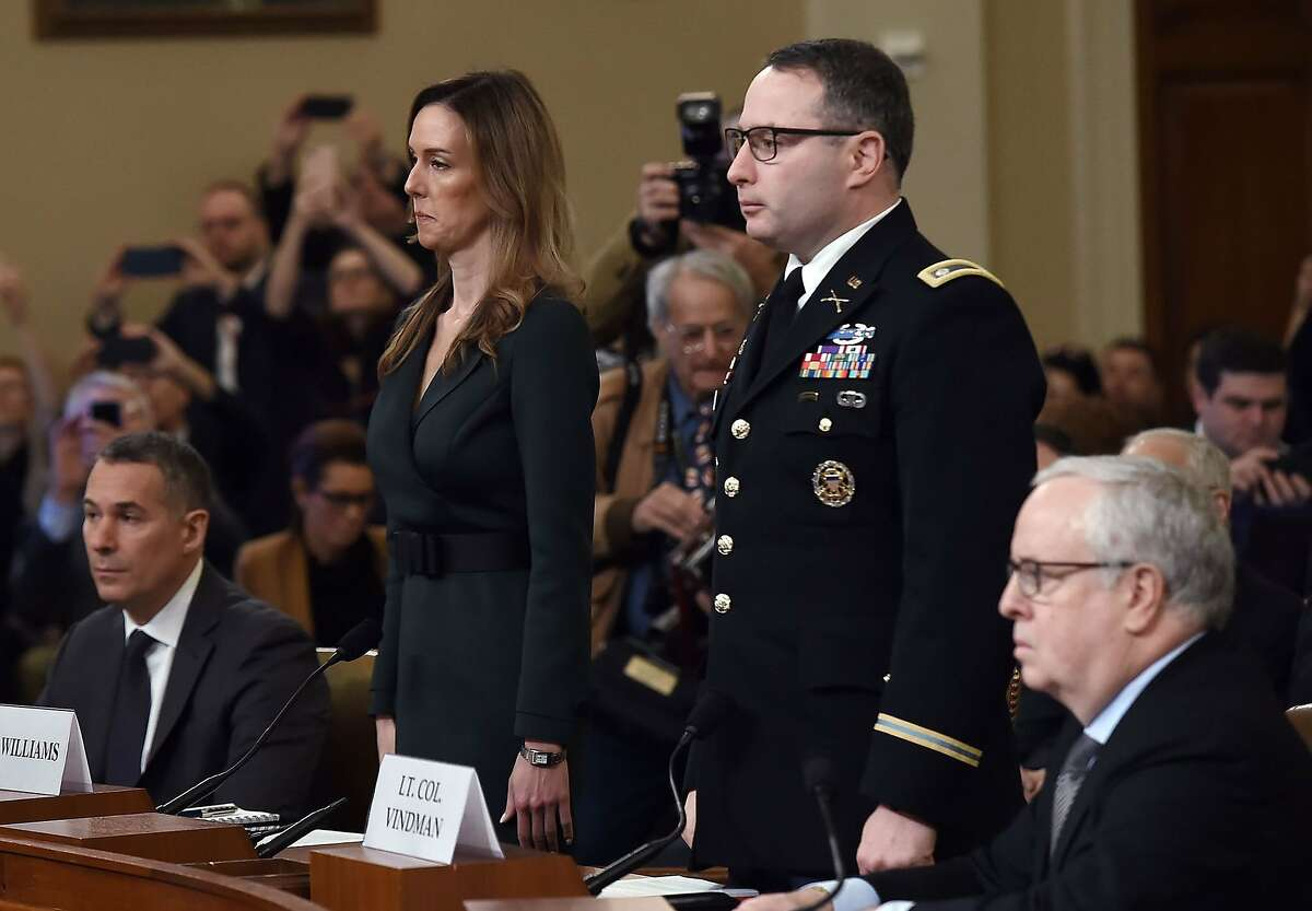 National Security Council Ukraine expert Lieutenant Colonel Alexander Vindman and Jennifer Williams, an aide to Vice President Mike Pence arrive to testify during the House Intelligence Committee hearing, into President Donald Trump's alleged efforts to tie US aid for Ukraine to investigations of his political opponents, on Capitol Hill in Washington, DC on November 19, 2019. - President Donald Trump faces more potentially damning testimony in the Ukraine scandal as a critical week of public impeachment hearings opens Tuesday in the House of Representatives.
