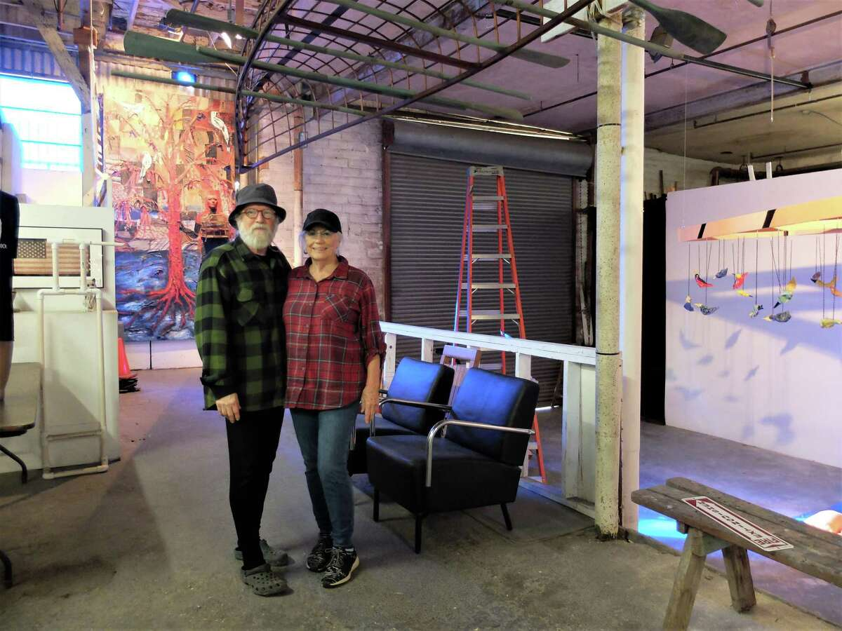 Mother Dog Studio founders and directors John Runnels and Charlie Jean Sartwelle in the entrance to the space, which hosts the 27th annual Art Crawl Saturday.