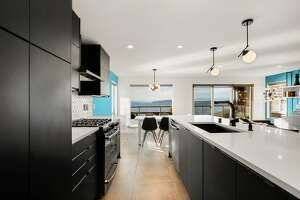 Occasional vacation home or vacation all the time: this $7.5K condo sits right on Alki Beach.