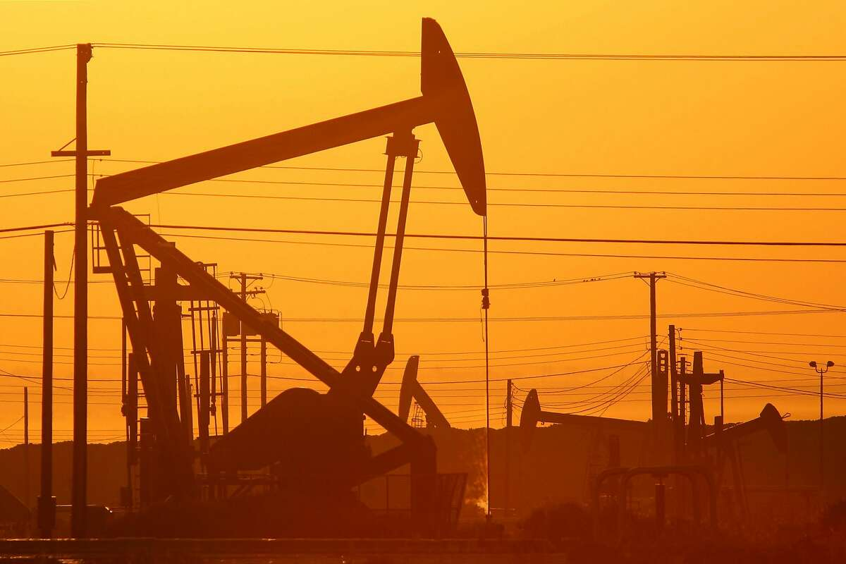 LOST HILLS, CA - MARCH 24: Pump jacks are seen at dawn in an oil field over the Monterey Shale formation where gas and oil extraction using hydraulic fracturing, or fracking, is on the verge of a boom on March 24, 2014 near Lost Hills, California. Critics of fracking in California cite concerns over water usage and possible chemical pollution of ground water sources as California farmers are forced to leave unprecedented expanses of fields fallow in one of the worst droughts in California history. Concerns also include the possibility of earthquakes triggered by the fracking process which injects water, sand and various chemicals under high pressure into the ground to break the rock to release oil and gas for extraction though a well. The 800-mile-long San Andreas Fault runs north and south on the western side of the Monterey Formation in the Central Valley and is thought to be the most dangerous fault in the nation. Proponents of the fracking boom saying that the expansion of petroleum extraction is good for the economy and security by developing more domestic energy sources and increasing gas and oil exports. (Photo by David McNew/Getty Images)