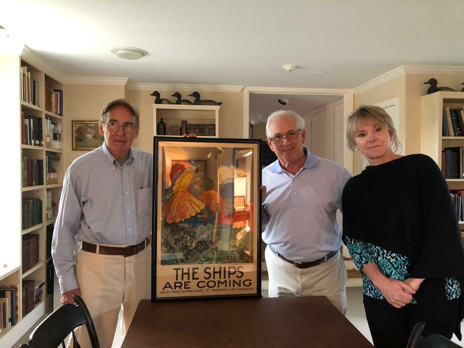 William Van Loan, left, David Polett, Co-Curator of the World War I exhibit, and Maggie McIntire, Executive Director of the Darien Historical Society. Photo: Contributed /