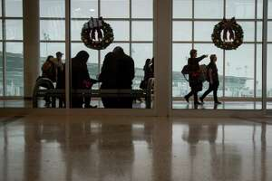 People arrive at Hobby Airport the week of Thanksgiving, Monday, Nov. 19, 2018, in Houston.