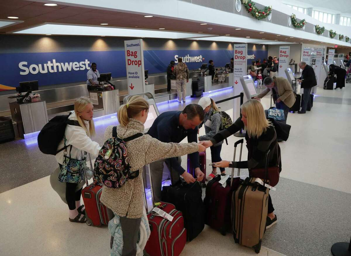 Stacy Pitts, from right, her daughter Avery, 10, her husband Kevin, daughter Ellie, 13, and other daughter Addy, 14, prepare for a flight at Hobby Airport on the Monday before Thanksgiving last year.