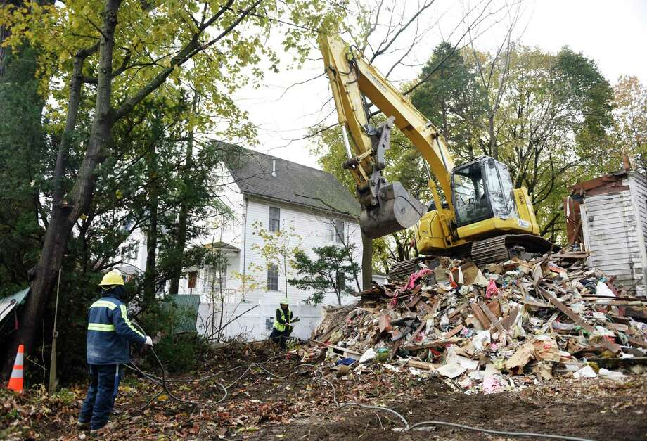 Crews demolish the blighted house at 46 Mead Ave. in the Byram section of Greenwich, Conn. Tuesday, Nov. 19, 2019. Photo: Tyler Sizemore / Hearst Connecticut Media / Greenwich Time