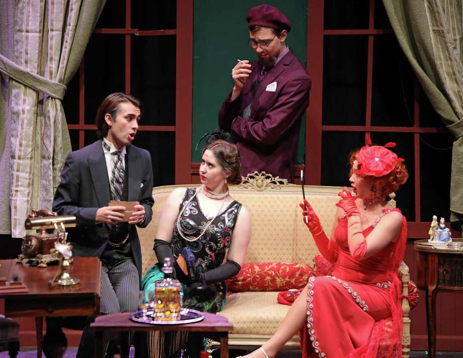 "Wadsworth exposes Mrs. Peacock. Left: Dustin Valenti as Wadsworth in the New Canaan High School production of ""Clue,"" which is sold out this weekend. Nicole Demers as Mrs. Peacock is seated at center, Alessio Pantaleo as Professor Plum is standing in back, and Devin Findlay as Miss Scarlet is seated at right. Photo: Contributed Photo / New Canaan High School / New Canaan Advertiser Contributed"