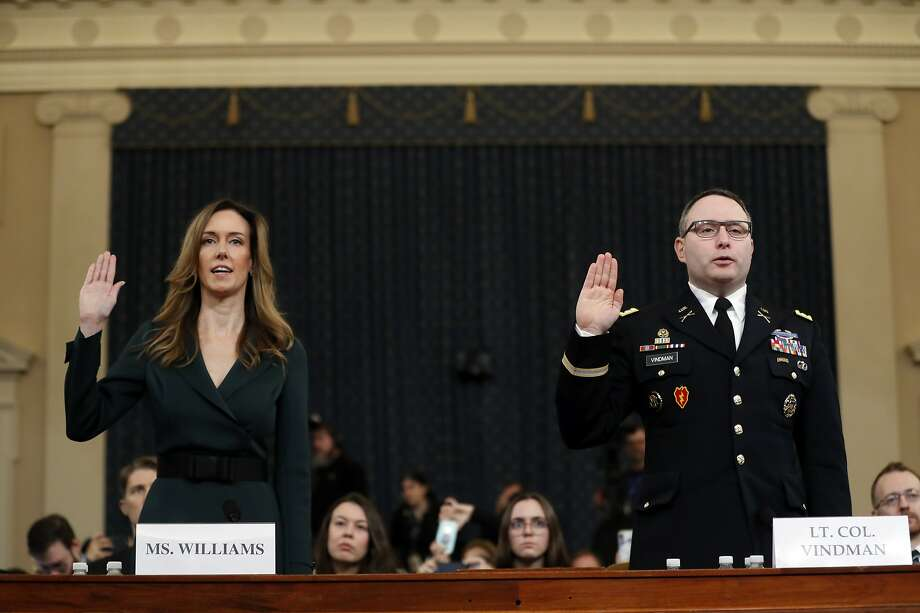 Jennifer Williams, an aide to Vice President Mike Pence, left, and National Security Council aide Lt. Col. Alexander Vindman, are sworn in to testify before the House Intelligence Committee on Capitol Hill in Washington, Tuesday, Nov. 19, 2019, during a public impeachment hearing of President Donald Trump's efforts to tie U.S. aid for Ukraine to investigations of his political opponents. (AP Photo/Andrew Harnik) Photo: Andrew Harnik, Associated Press