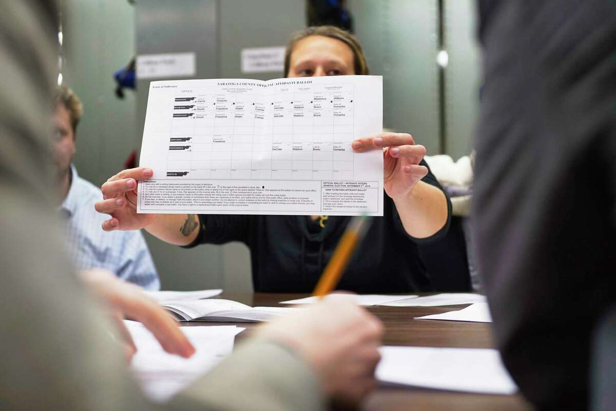 Kelly Fusco, the senior Republican clerk for the the Saratoga County Board of Elections, shows an absentee ballot during a count on Tuesday, Nov. 19, 2019 in Ballston Spa, N.Y. Absentee ballots were being counted in the Stillwater Town Council race between Lisa Bruno and Valerie Masterson. (Paul Buckowski/Times Union)