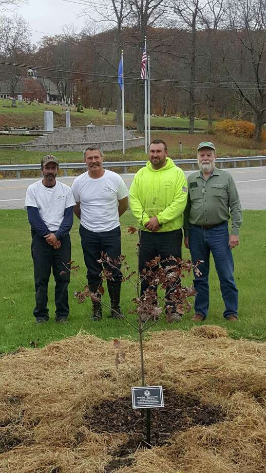The Connecticut Tree Protective Association will plant a white oak tree in every city and town within Connecticut in the fall of 2019. Above, from left to right, Bill Brague and Bill Pollock of Arbor Services of CT join Josh Tanner and Craig Nelson with the Town of Warren at the town's Oct. 30 tree planting. Photo: Courtesy Of Connecticut Tree Protective Association / The News-Times Contributed