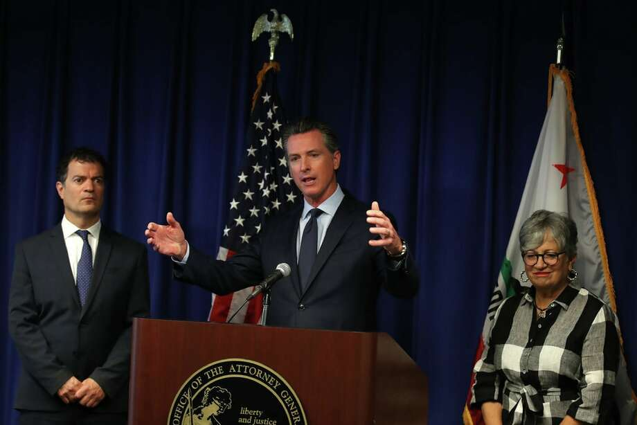 Gov. Gavin Newsom of California with Mary D. Nichols, right, chairwoman of the state's clean air regulator, and Jared Blumenfeld, secretary of the California Environmental Protection Agency, in September. Photo: Justin Sullivan/Getty Images