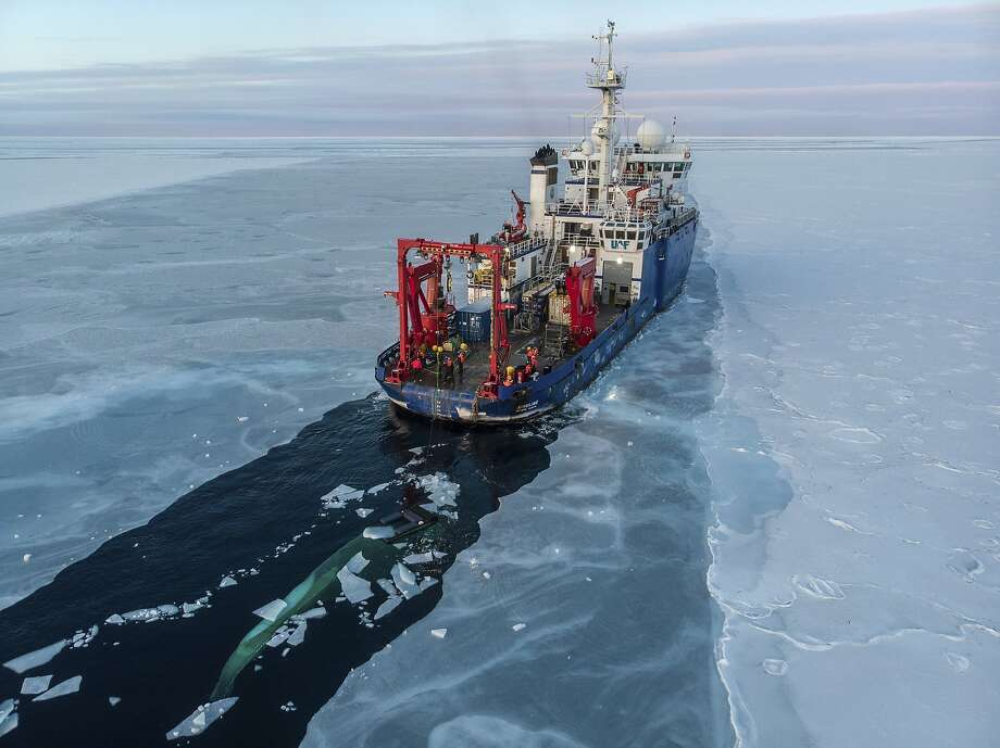 In this Nov. 14, 2019, photo provided by John Guillote and taken from an aerial drone shows the U.S. research vessel Sikuliaq as it makes its way through sea ice in the Beaufort Sea off Alaska's north coast. University of Washington scientists onboard the research vessel are studying the changes and how less sea ice will affect coastlines, which already are vulnerable to erosion because increased waves delivered by storms. More erosion would increase the chance of winter flooding in villages and danger to hunters in small boats. (John Guillote via AP) Photo: John Guillote / Associated Press 2019