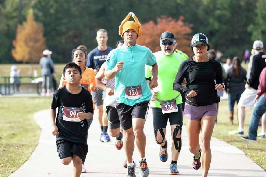 The Woodlands resident Noah Sam runs through the first leg of the 2018 Turkey Trot 5K on Saturday, Nov. 17, 2018 at Carl Barton, Jr. Park in Conroe. This year's event is set for this Saturday morning at Carl Barton Jr. Park in Conroe. Photo: Cody Bahn, Houston Chronicle / Staff Photographer / © 2018 Houston Chronicle