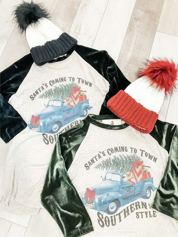 "11. ""Santa's Coming to Town Southern Style"" Tee, YaYa ClubVelvet sleeves give this kitschy raglan style T-shirt a tinge of glamor. It's the perfect gift for the friend with a sense of humor and Southern flair.Santa's Coming to Town Southern Style Tee, $30YaYa Club123 FM 1960www.yayaclubclothing.com Photo: Courtesy Photo"