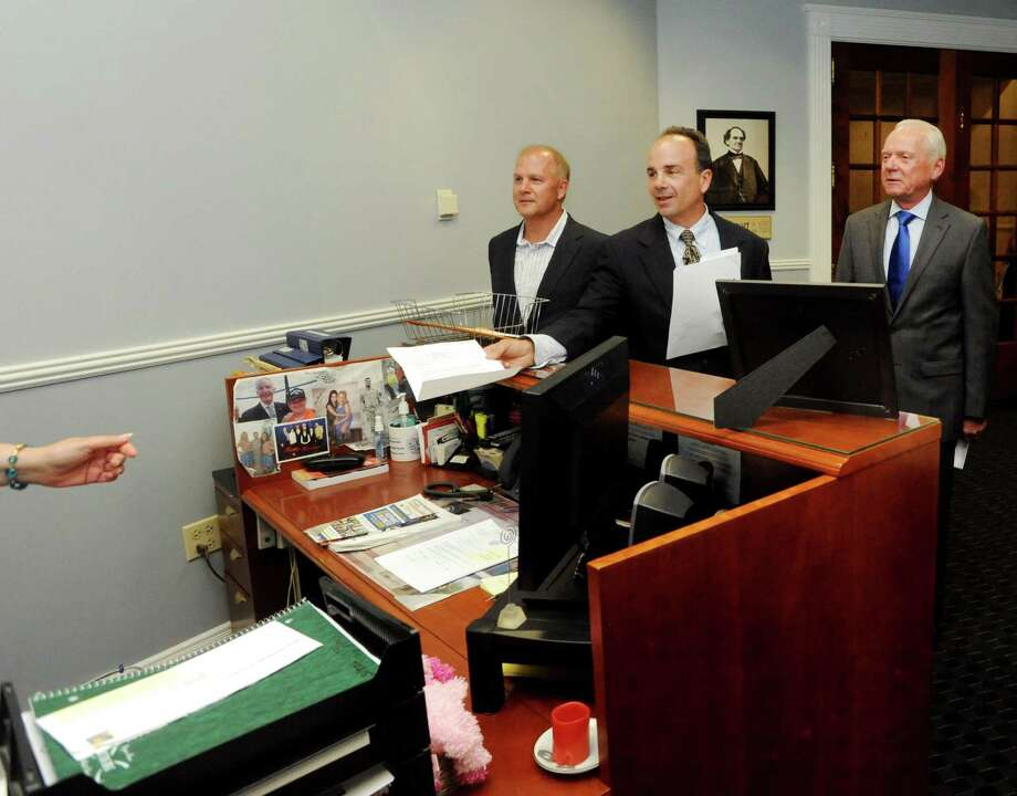 Candidate Joe Ganim delivers his Office of Public Integrity proposal to Bridgeport Mayor Bill Finch's office on Monday, Aug. 10, 2015. With Ganim is ex-FBI Agent Ed Adams, right, who helped convict Ganim and then volunteered for his comeback campaign. Photo: File Photo / Connecticut Post