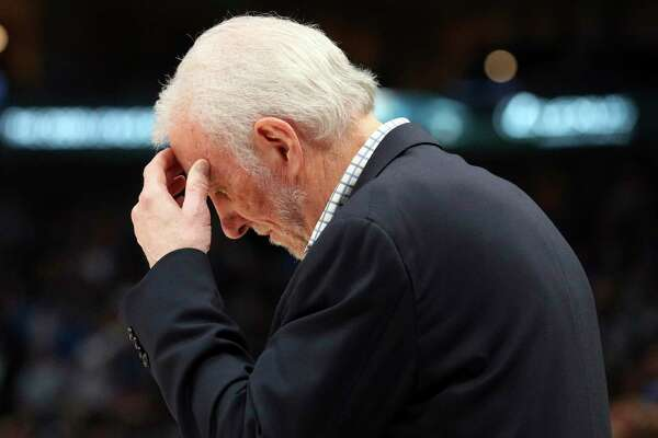 San Antonio Spurs head coach Gregg Popovich reacts near the end of an NBA football game against the Dallas Mavericks, Monday, Nov. 18, 2019, in Dallas. (AP Photo/Richard W. Rodriguez)