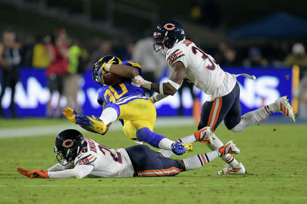 Los Angeles Rams running back Todd Gurley, middle, is tackled by Chicago Bears cornerback Prince Amukamara, bottom, and free safety Eddie Jackson during the second half of an NFL football game Sunday, Nov. 17, 2019, in Los Angeles.