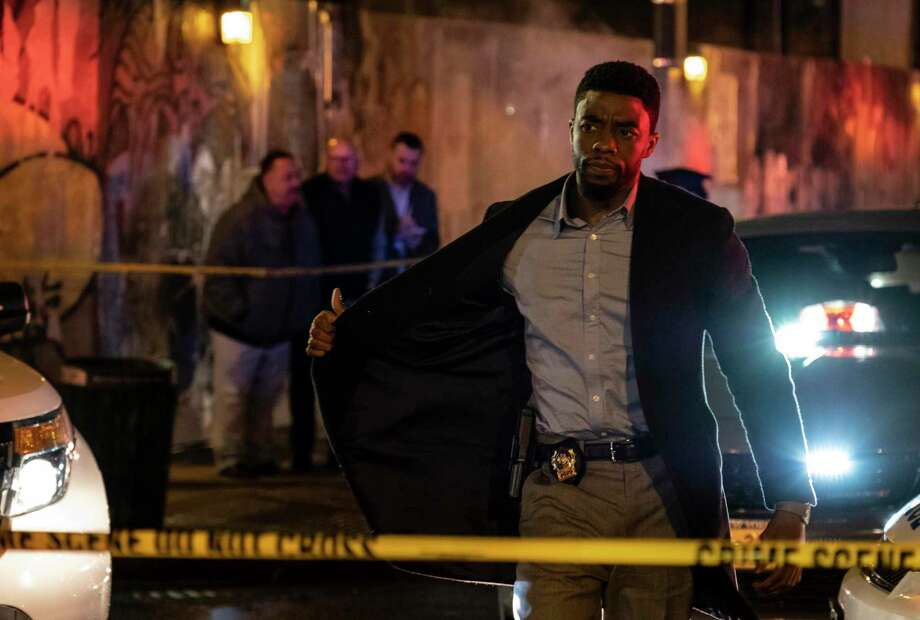 "This image released by STXfilms shows Chadwick Boseman in a scene from ""21 Bridges,"" in theaters on Nov. 22. (Matt Kennedy/STXfilms via AP) Photo: Matt Kennedy, HONS / Associated Press / Motion Picture Artwork © 2017 STX Financing, LLC. All Rights Reserved."