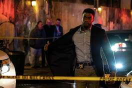 "This image released by STXfilms shows Chadwick Boseman in a scene from ""21 Bridges,"" in theaters on Nov. 22. (Matt Kennedy/STXfilms via AP)"