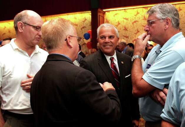 Michael Fedele, center, Republican candidate for Governor of Connecticut, chats with Jeff Muthersbaugh, of Bethel, Danbury Mayor Mark Boughton, and Gregg Seabury, of Danbury during primary election night at the Italian Community Center in Stamford, August 10, 2010. Photo: Chris Ware / The News-Times