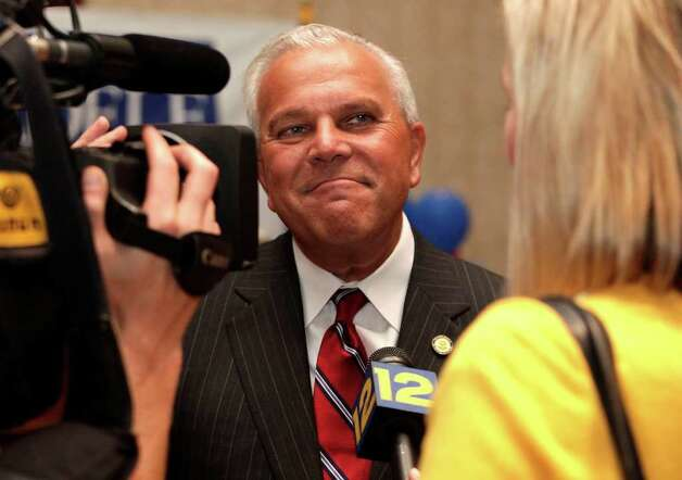Michael Fedele, Republican running for Governor of Connecticut chats with Kimber Crandall of News 12 during primary election night at the Italian Community Center in Stamford, August 10, 2010. Photo: Chris Ware / The News-Times