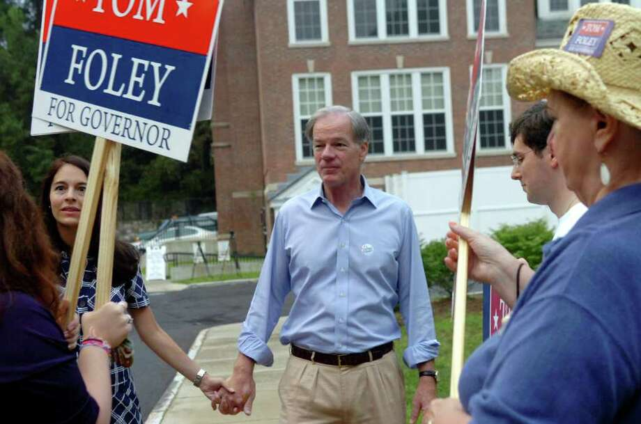 Tom Foley, Republican candidate for governor,  leaving the Bendleim Western Greenwich Civic Center with his wife, Leslie, after voting, on Tuesday, Aug. 10, 2010. Photo: Helen Neafsey / Greenwich Time
