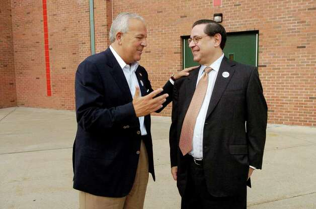 Michael Fedele talks to Mike Totilo, his treasurer, after voting at Scofield Middle School in Stamford, Conn. on Tuesday August 10, 2010. Photo: Dru Nadler / Stamford Advocate