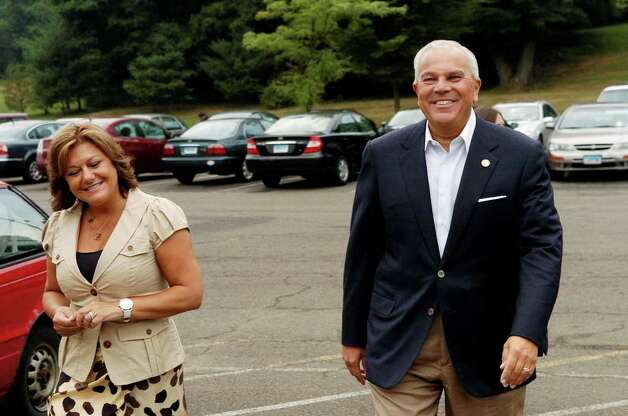 Michael and Carol Fedele arrive at Scofield Middle School in Stamford, Conn. to cast thier votes on Tuesday August 10, 2010. Photo: Dru Nadler / Stamford Advocate