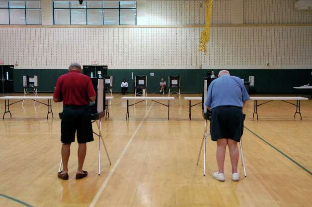 Voters fill out their ballots at Scofield Middle School in Stamford, Conn. on Tuesday August 10, 2010. Photo: Dru Nadler / Stamford Advocate