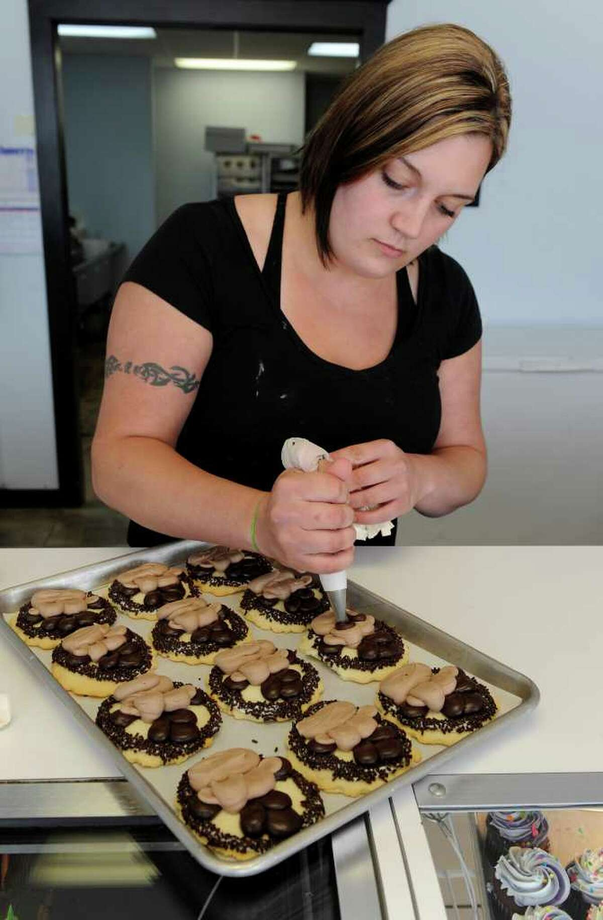 Salina Crisafulli decorates cookies at Sweet Temptations in Colonie on Tuesday, Aug. 10, 2010. (Skip Dickstein/Times Union)