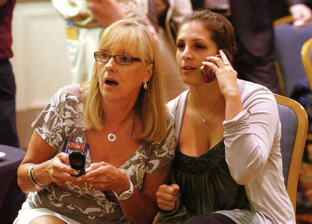 Tom Foley campaign volunteers Karen Arnold, of Orange, at left, and her daughter Lindsey, watch results while at Foley's Republican primary day party at the Mariott Hotel in Rocky Hill, Conn. on Tuesday August 10, 2010. Photo: Christian Abraham / Connecticut Post