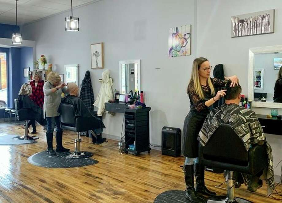 Stylist are hard at work at the new Blown Away Salon in downtown Reed City, owned and operated by longtime resident Heather Hammer. (Herald Review photo/Cathie Crew)