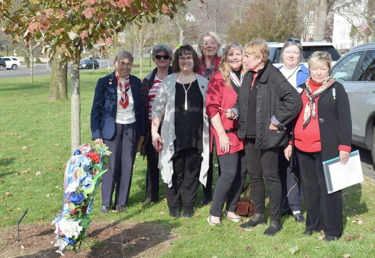 The Roger Sherman Chapter, Daughters of the American Revolution dedicated a plaque to Vietnam veterans beneath a tree they planted this spring in honor of Vietnam veterans. The ceremony took place on Veterans Day, Nov. 11. Above are, from left to right, Heidi Norcross, Jennie Rehnberg, Tricia Gregory and Bonnie Butler and, in back, Pat Pavlick, Mary Schenzer, Katy Francis and Marcella Martin.