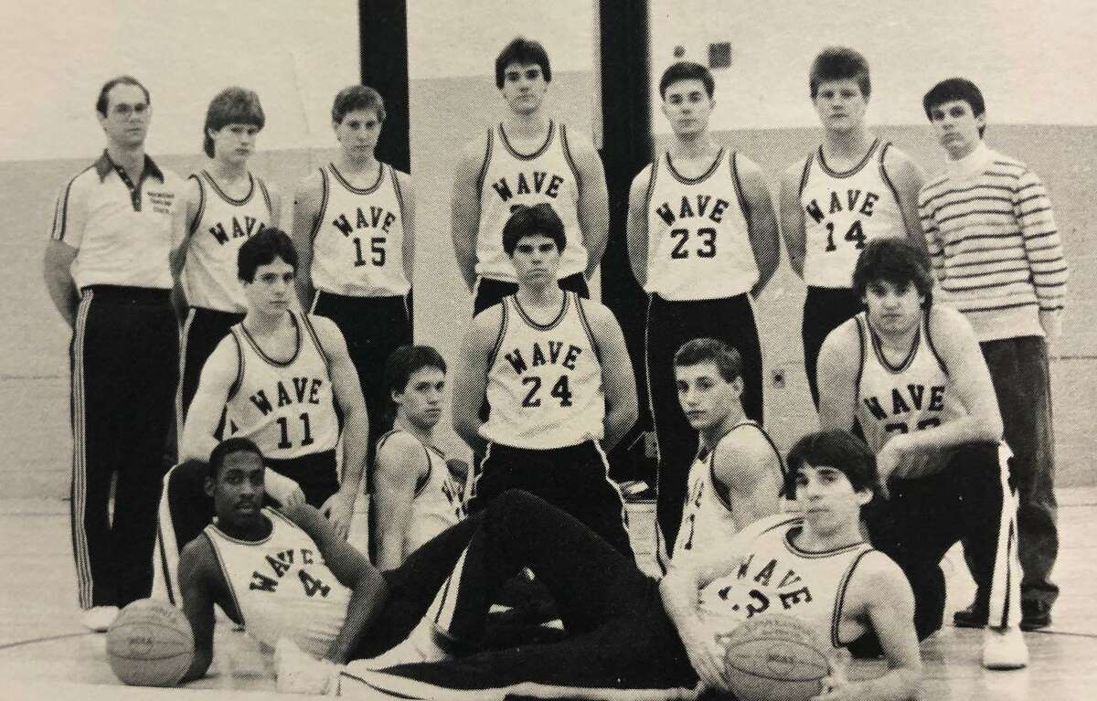 """The New Milford High School boy's basketball team didn't have the year it had hoped for during the academic year 1986-87, but it finished the season with a 7-12 record. Not the powerhouse WCC of years past, Coach Bill Hibbard's """"5"""" showed moments of strength, according to the yearbook that year. One memorable moment of the season included Jamie Scrimgeour finishing the season with 734 points, placing him third on the NMHS career scoring list, behind only Tucker Burke and John Ndukwu, as of that year. Above are, from left to right, in front, Darnell Fikes and Jamie Scrimgeour; second row, Paul Marrazita, Jeff Rose, Neil Brooks, Jack Lavalette and Jim Wood; and in back, Coach Hibbard, Craig Wells, Patrick Heaton, Tom Halvorsen, Steve McCall, S. Yoakum and Peter Ciccone. Missing is Daniel Arciola. If you have a """"Flashback"""" photograph to share, contact Deborah Rose at drose@newstimes.com or 860-355-7324."""