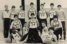 "The New Milford High School boy's basketball team didn't have the year it had hoped for during the academic year 1986-87, but it finished the season with a 7-12 record. Not the powerhouse WCC of years past, Coach Bill Hibbard's ""5"" showed moments of strength, according to the yearbook that year. One memorable moment of the season included Jamie Scrimgeour finishing the season with 734 points, placing him third on the NMHS career scoring list, behind only Tucker Burke and John Ndukwu, as of that year. Above are, from left to right, in front, Darnell Fikes and Jamie Scrimgeour; second row, Paul Marrazita, Jeff Rose, Neil Brooks, Jack Lavalette and Jim Wood; and in back, Coach Hibbard, Craig Wells, Patrick Heaton, Tom Halvorsen, Steve McCall, S. Yoakum and Peter Ciccone. Missing is Daniel Arciola. If you have a ""Flashback"" photograph to share, contact Deborah Rose at drose@newstimes.com or 860-355-7324."