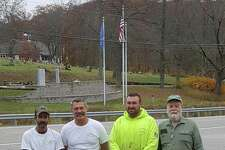 The Connecticut Tree Protective Association will plant a white oak tree in every city and town within Connecticut in the fall of 2019. Above, from left to right, Bill Brague and Bill Pollock of Arbor Services of CT join Josh Tanner and Craig Nelson with the Town of Warren at the town's Oct. 30 tree planting.