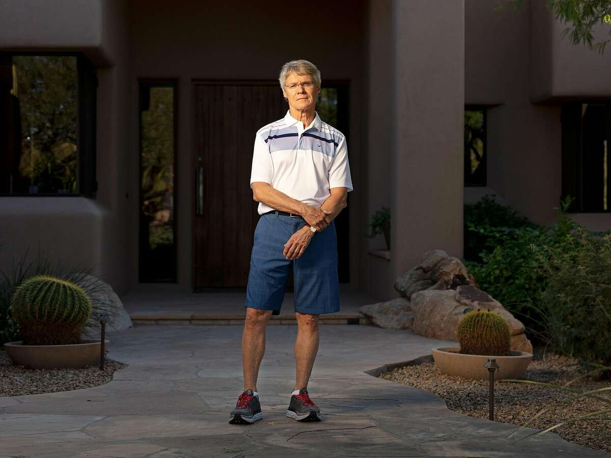 Michael Baker, the retired owner of a medical device distributor, whose home sits under a flight path, in Scottsdale, Ariz. on Nov. 7, 2019. The Federal Aviation Administration is rolling out a system that allows planes to fly closer to one another, but the roar that it creates is unbearable, people in the flight paths say. (Cassidy Araiza/The New York Times)