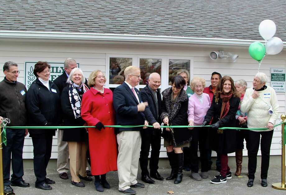 Daily Bread Food Pantry's dedication and ribbon cutting ceremony drew a crowd of about 75 supporters outside of Saint James Episcopal Church in Danbury on Nov. 14. The crowd included donors, volunteers, supporters, city and Department of Housing and Urban Development officials and Ridgefield Thrift Shop President Sandra Capriotti and Finance Committee Head Debbie Murphy. The Thrift Shop donated $10,000 for the renovation project. Speakers included Mayor Boughton, Alanna Kabel, director of community planning and development at HUD's Hartford Field Office, and architect Leigh Overland. Photo: Contributed Photo